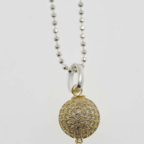 Cubic zirconia reversible sphere yellow gold plated pendant necklace