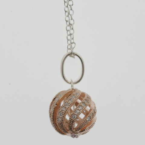 Cubic zirconia swirling sphere rose gold plated necklace