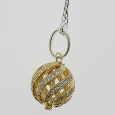 Cubic zirconia swirling sphere yellow gold plated necklace