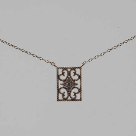 Detailed rectangle diamond and rose gold necklace