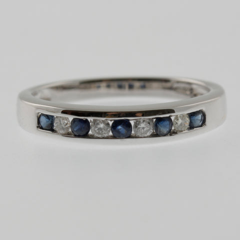 Diamond and sapphire channel set ring band