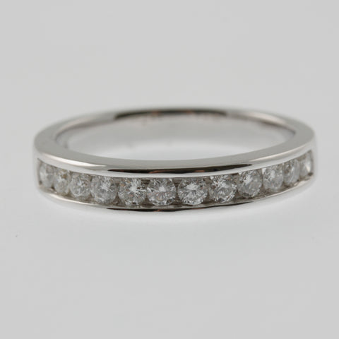 Diamond channel set ring band