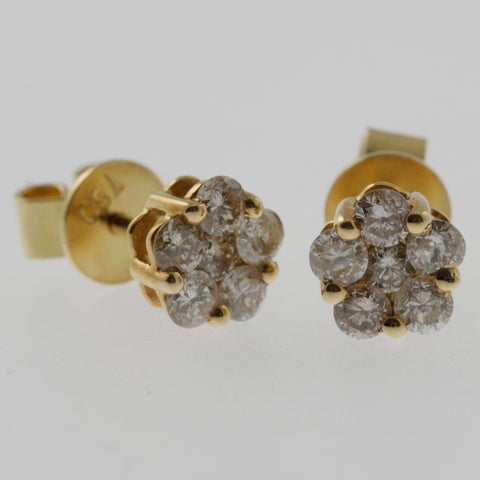 Diamond flower studs in yellow gold