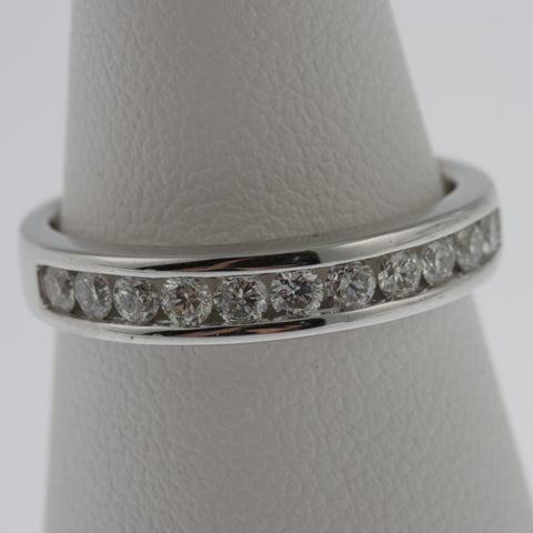 Diamond ring band channel set with round diamonds in 18 ct white gold