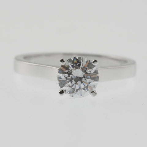 Diamond solitaire ring round brilliant cut 4 claw square band