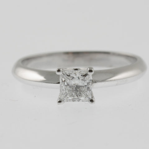 Diamond solitaire ring square princess cut 4 claw knife edge band