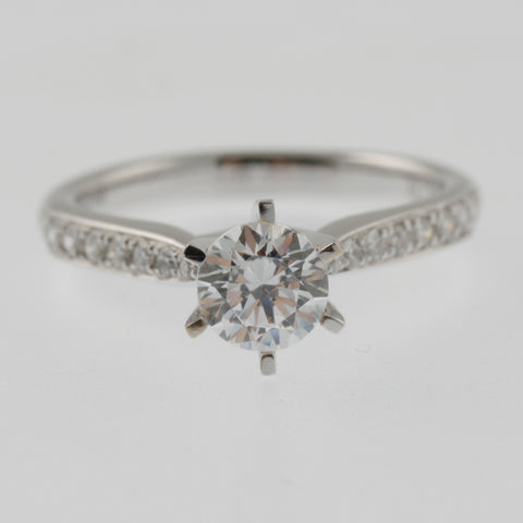 Diamond solitaire round brilliant 6 claw ring with round brilliant diamond shoulders bead set in 18ct white gold