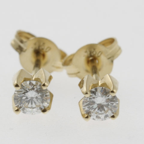 Diamond studs 20 points each in yellow gold