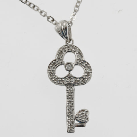 Diamond white gold key pendant