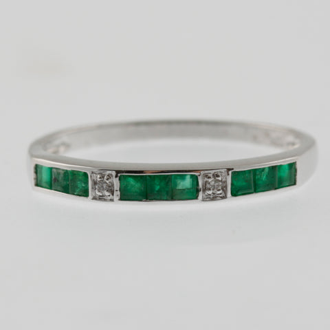 Emerald and diamond white gold ring band
