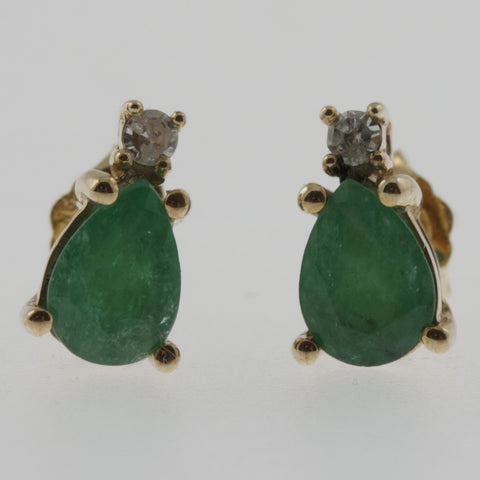 Emerald teardrop and diamond studs in 9 ct yellow gold