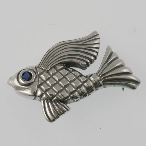 Fish brooch in sterling silver with blue cubic zirconia eye