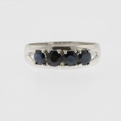 Four round sapphires 9 ct white gold band