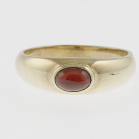 Garnet yellow gold band ring