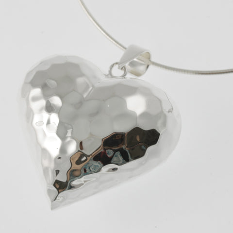 Heart 3D sterling silver pendant with a hand beaten finish
