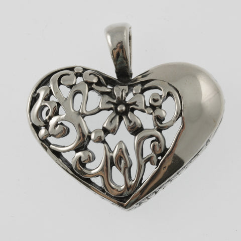 Heart sterling silver pendant with asymmetrical cut out detail