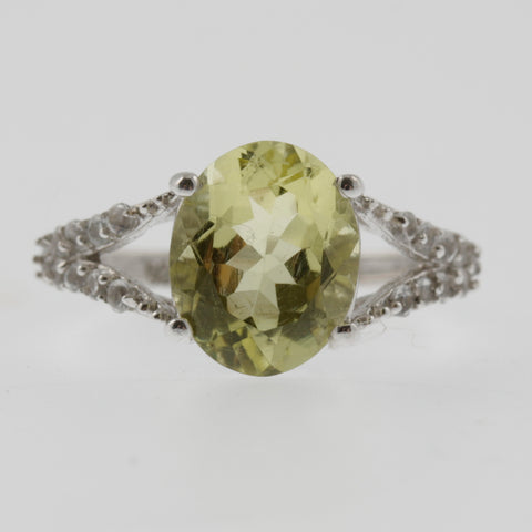 Lemon topaz oval with white topaz shoulders ring