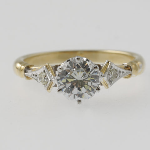 Diamond solitaire ring round brilliant cut with shoulder diamonds