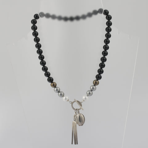 Monochrome necklace with sterling silver tassle and locket