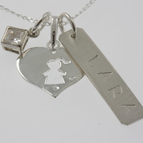 Personalised jewellery: child, name and a charm