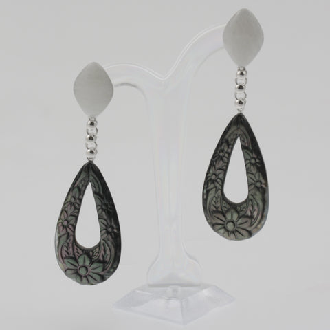 Ornate carved paua and mother of pearl earrings