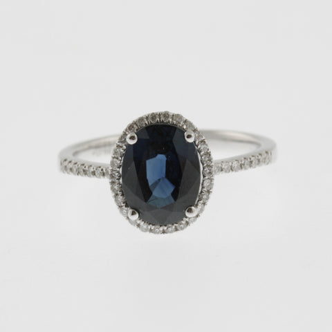 Oval sapphire with diamond halo and shoulders 4 claw ring 18 ct white gold