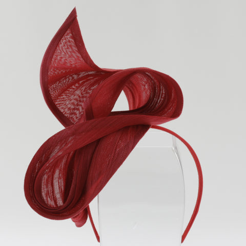 Red scuptural fascinator on headband