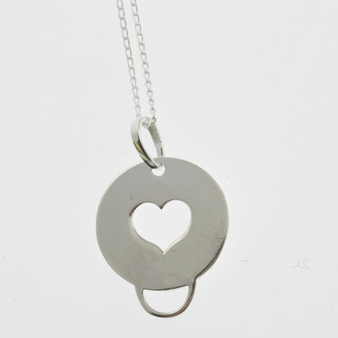 Round sterling silver pendant with heart cutout and loop
