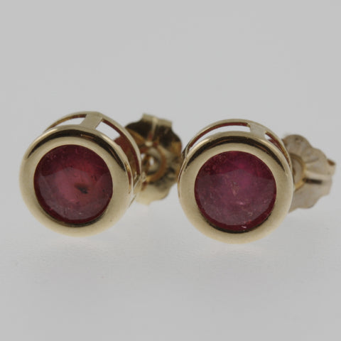 Ruby round 6mm studs in 14 ct yellow gold