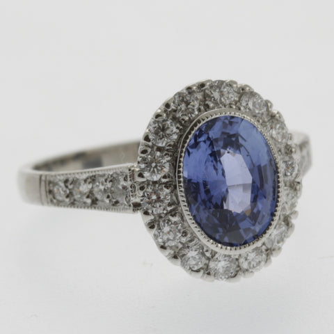 Oval sapphire and diamond halo vintage style ring