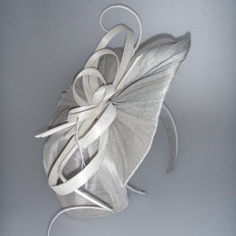 Silver and white paris cloth fascinator on headband