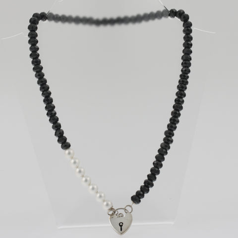 Heart locket on faceted onyx and white shell necklace