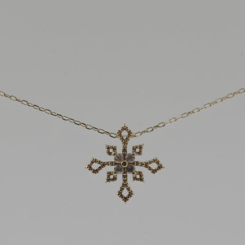 Snowflake diamond and yellow gold necklace