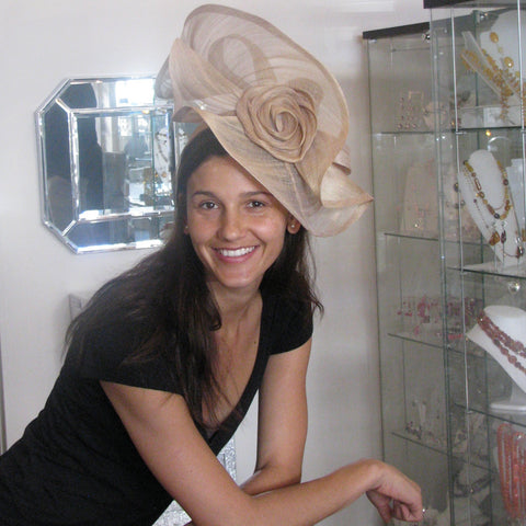 Swirling rose paris cloth fascinator on headband in soft gold
