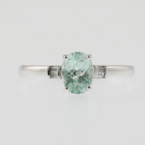 Green tourmaline oval ring with diamond shoulders in white gold