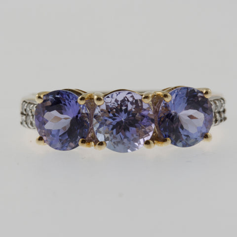 Triple round tanzanite and diamond ring in yellow gold