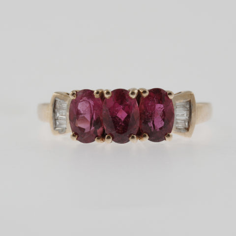 Triple rubilite and diamond baguette ring in rose gold