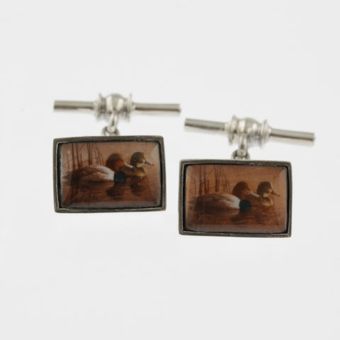 Vintage style sterling silver cufflinks with two ducks on water reflecting the sunset