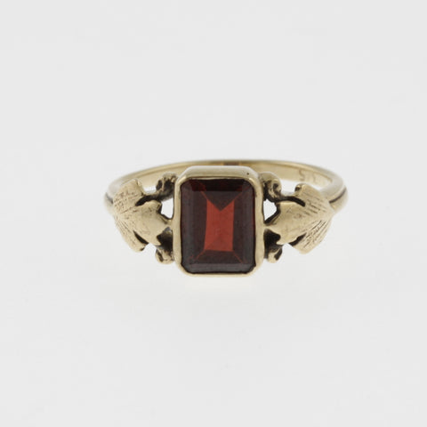 Vintage style emerald cut garnet yellow gold ring with leaf detail