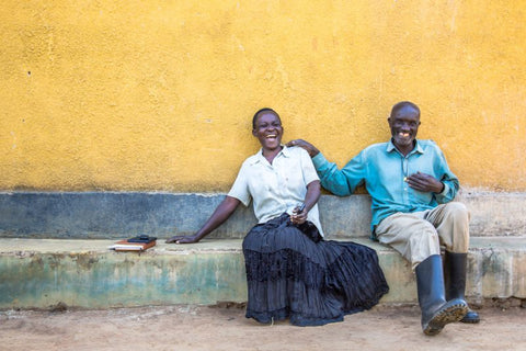Image of an african couple sat on a wall together