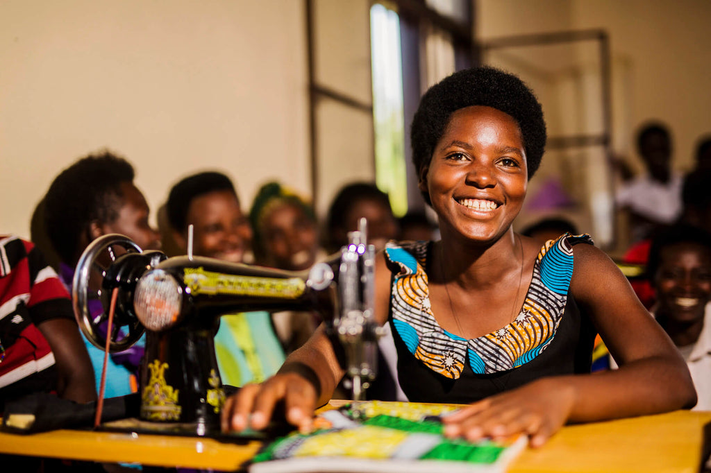 Image of a woman participant of the programme doing sewing