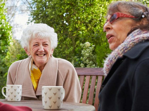 Two ladies enjoying tea outside