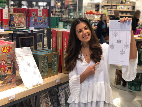 Kristina holding the Advent of Change advent calendar