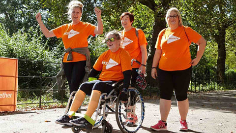 Image of MS Society supporters walking together with MS Society t-shirts on
