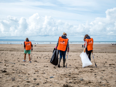 marine conservation society volunteers litter picking on beach
