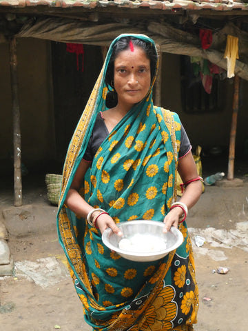 Image of an indian lady holding a bowl