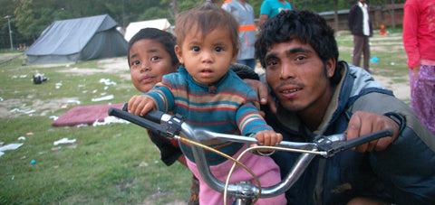 Image of family with little girl on bike