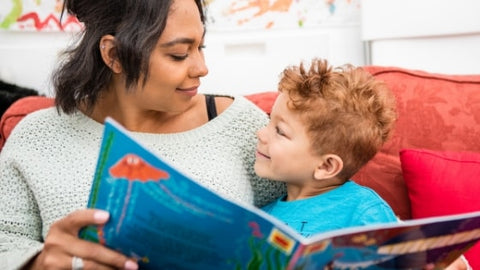 Image of a woman and child reading together