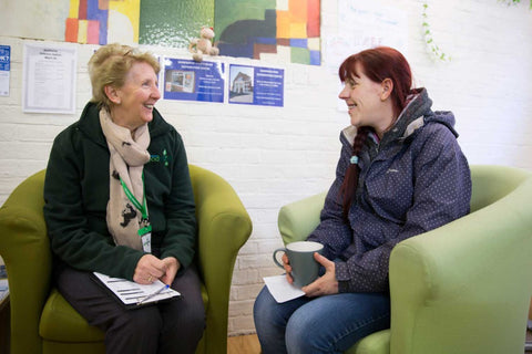 Trussell Trust volunteer chatting with client