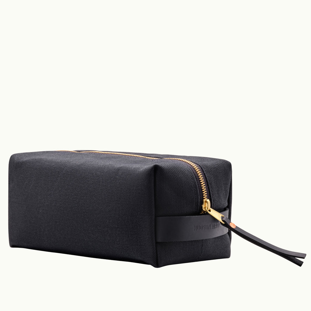 Hudson Made Black Waxed Cotton Dopp Kit with Embossed Hudson Made logo on the black saddle leather handle and a solid brass sturdy zipper.